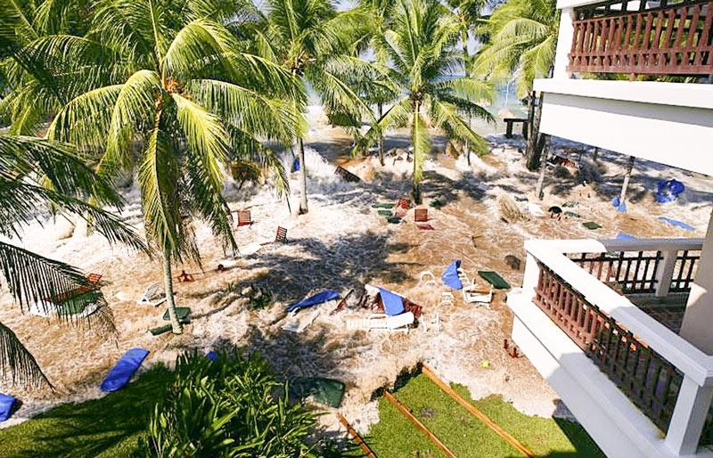 a scattered beach with broken furniture - view from a hotel that was hit by a Tsunami in Thailand in 2004