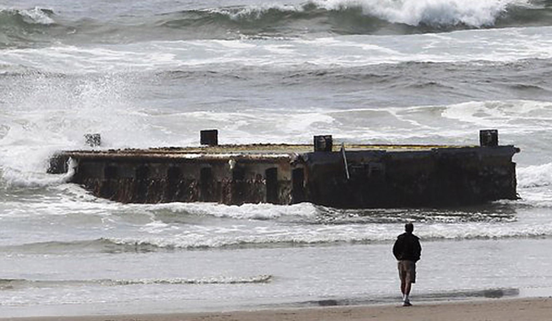 65 ft dock lying on its side washed up on the Oregon coast
